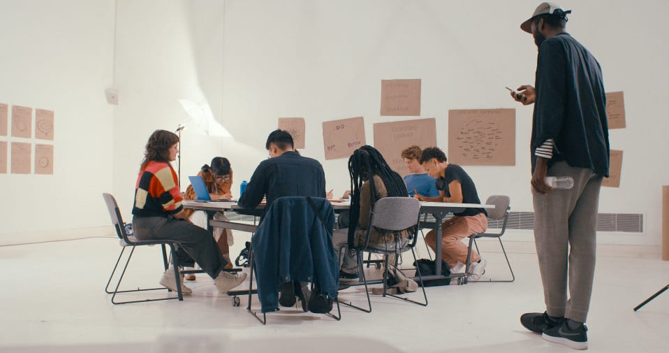 Group of people working together in a large white space