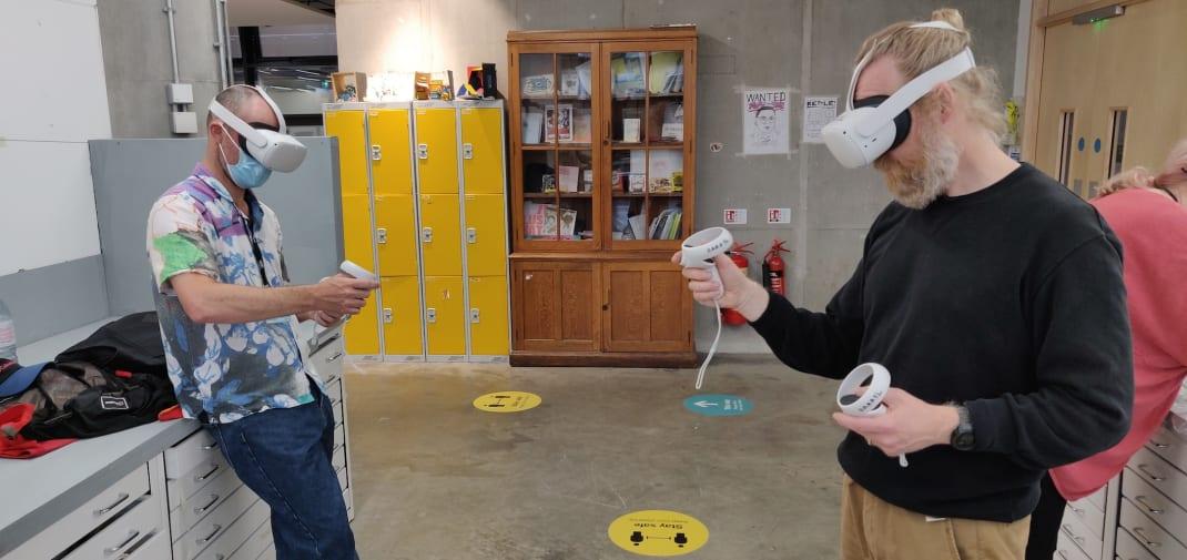 People using virtual reality head sets