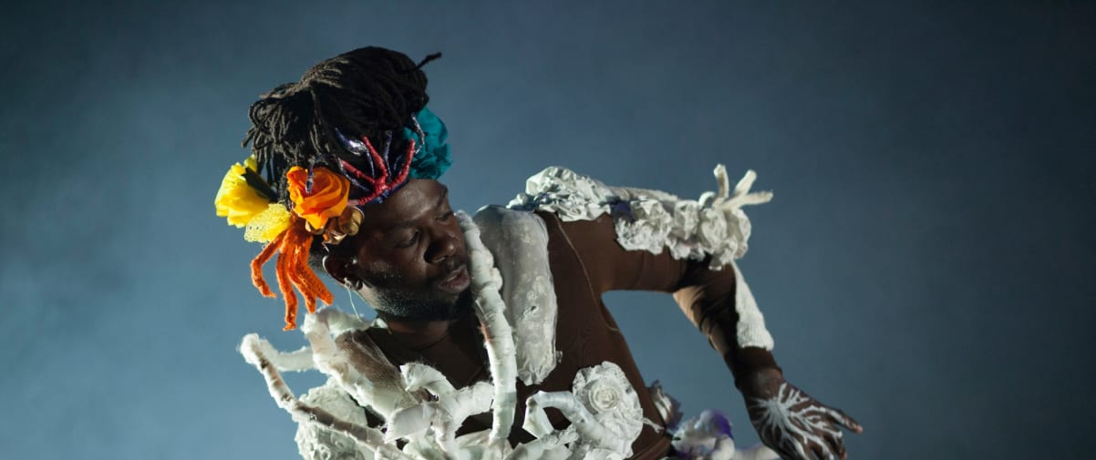 Performer wearing a a costume made of coral.