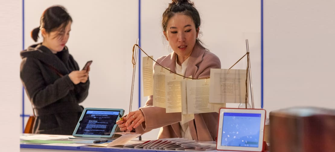 woman at ma aici festival with publications