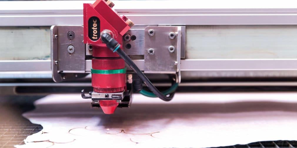 Close up shot of a laser cutting machine in process