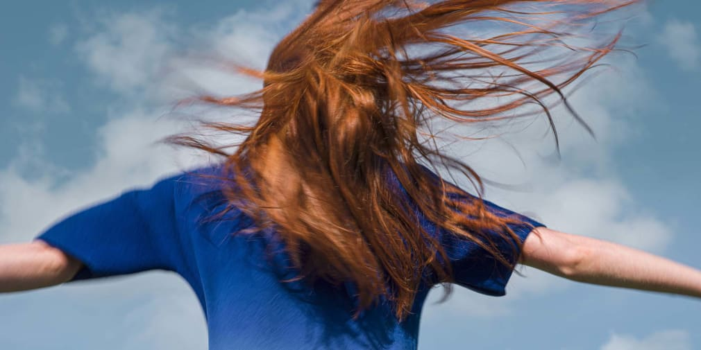 Photograph of a girl with her hair blowing in the wind