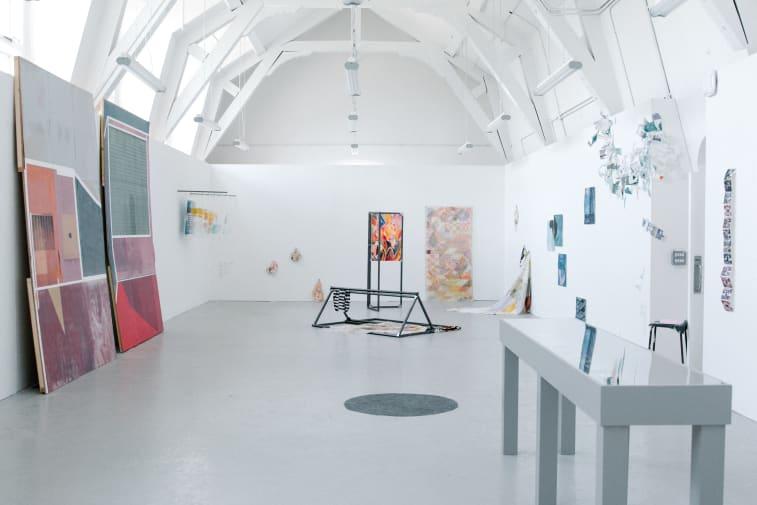 Studio workroom with various artworks