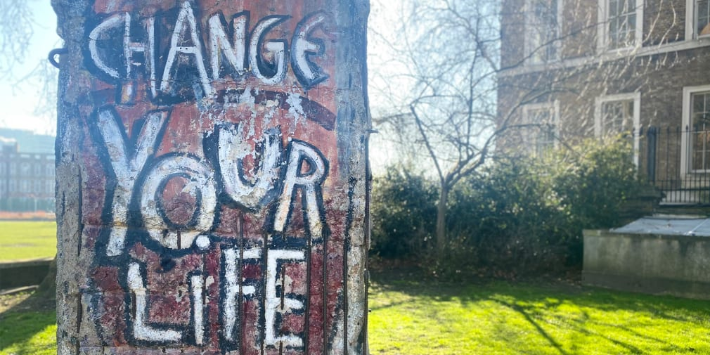 Photo of a tree which has 'Change your life' written on it