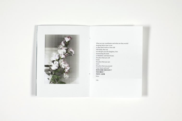 Hand bound book showing page with flowers