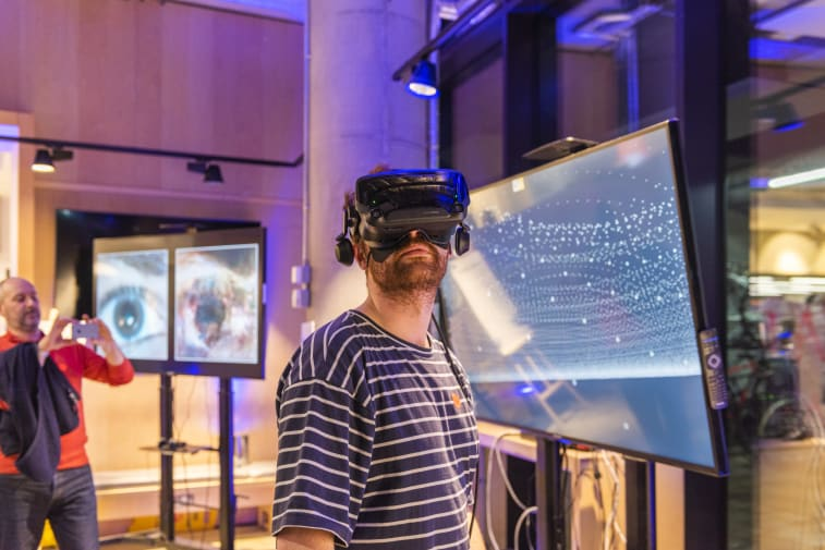 Visitor of the Creating Computing Institute wearing a VR headset