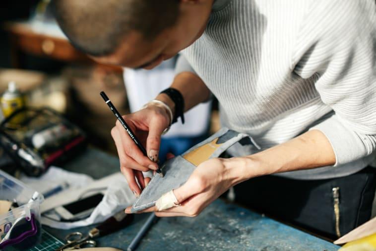 Boy working on a shoe