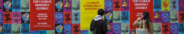 Climate Emergency Posters pinned to wall