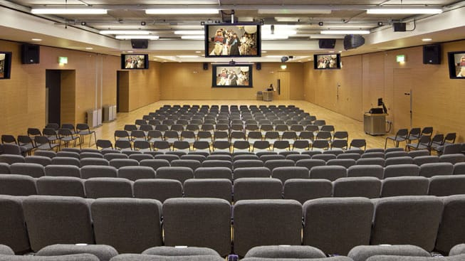 Rows of seats facing a screen in the LVMH Lecture Theatre at Central Saint Martins