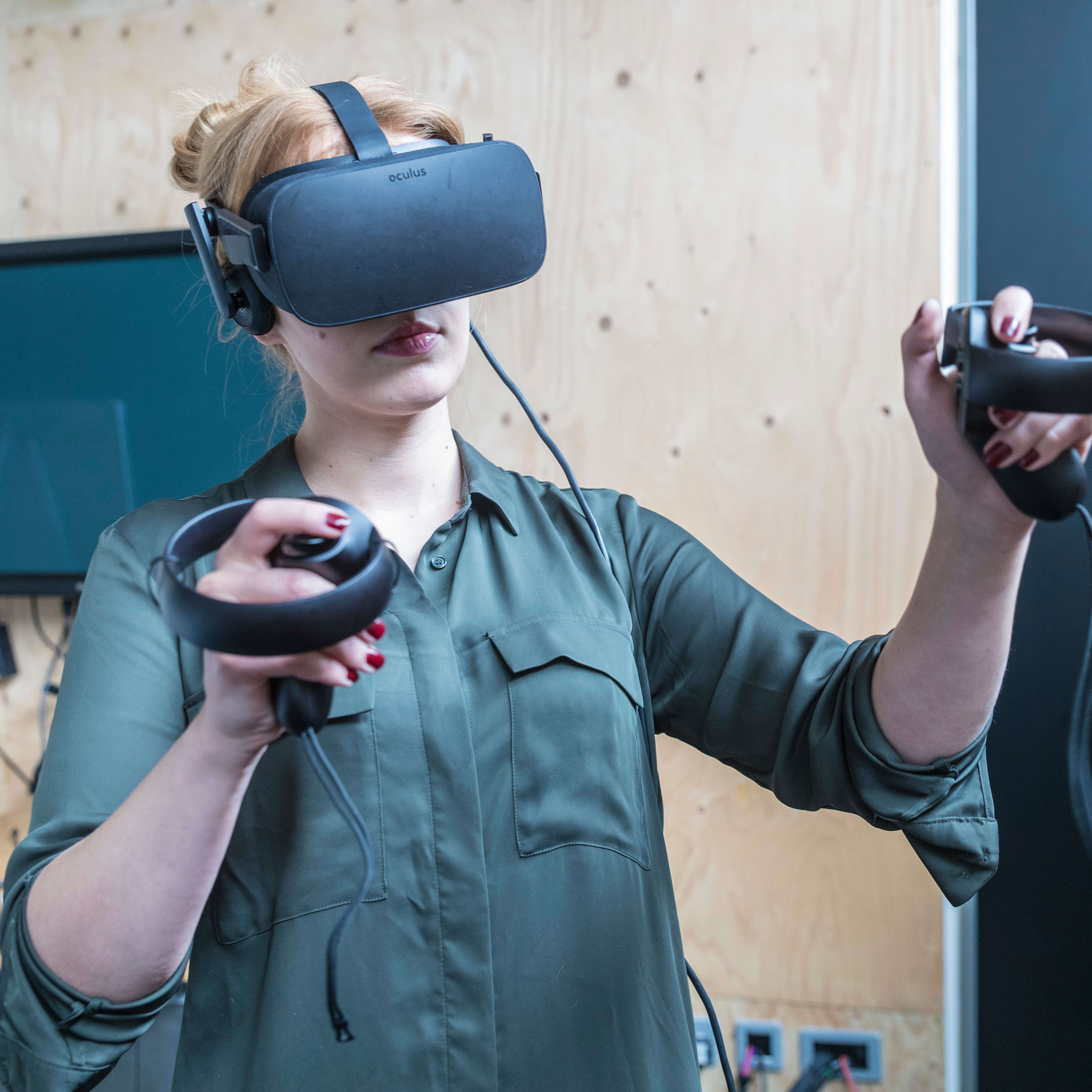 A person using a VR headset and controls