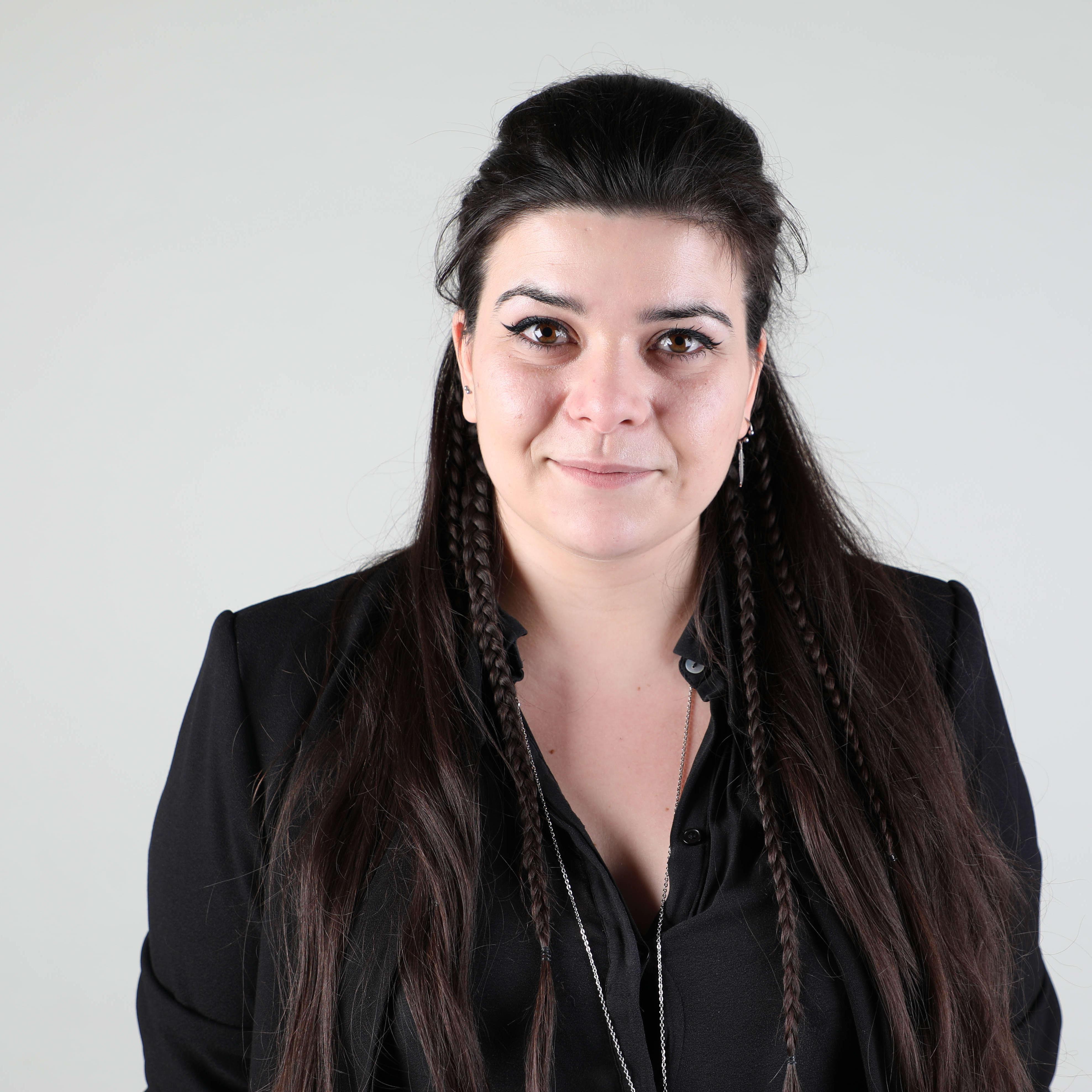Profile photo of woman looking at camera
