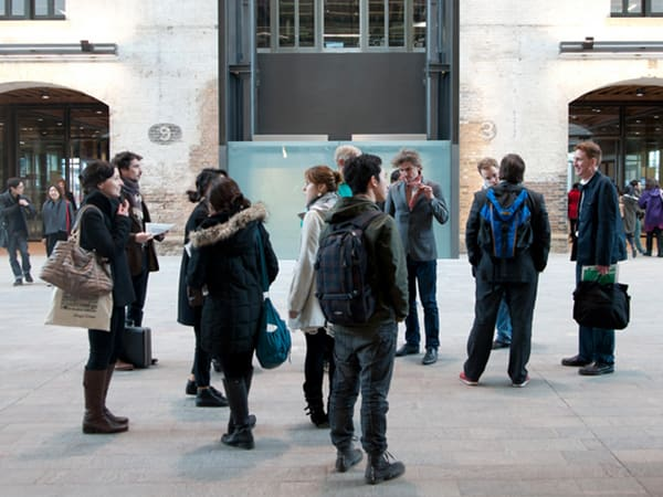 Visitors looking around the entrance of Central Saint Martins which is set in a Victorian grain store