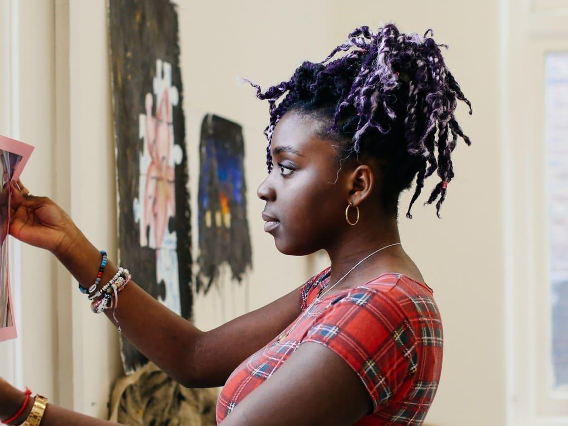 Student holding up artwork
