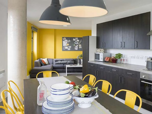 Photo of a grey and yellow kitchen