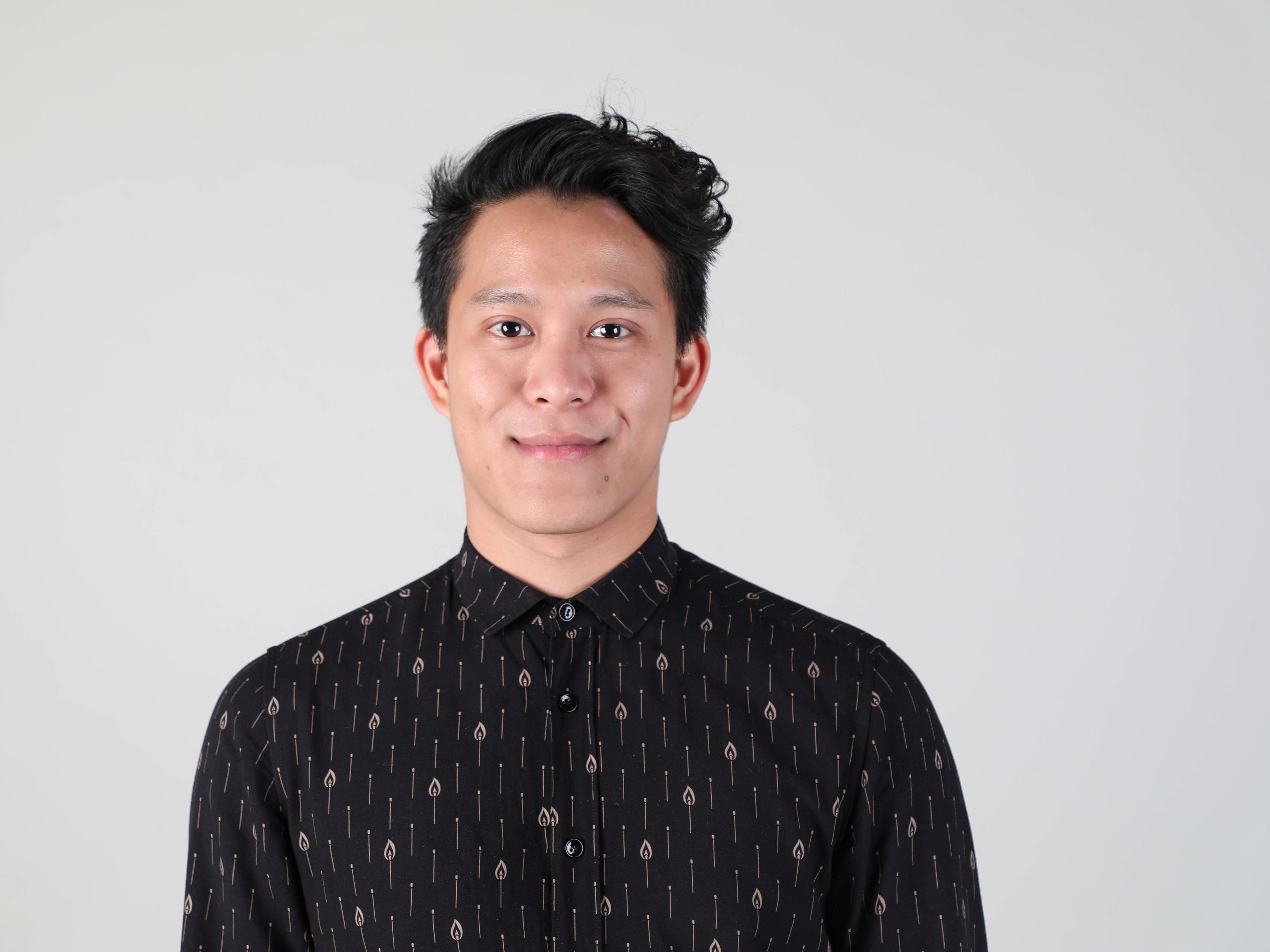Profile photo of man looking at camera