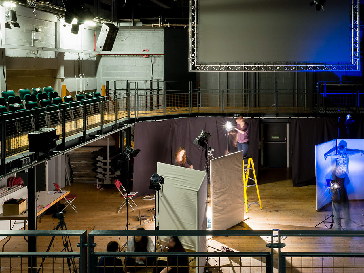 Students working in the Wimbledon College of Arts theatre.