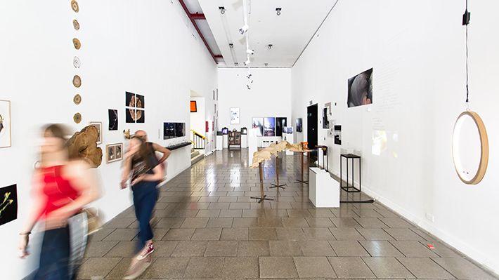 Figures walking through the Atrium Gallery.