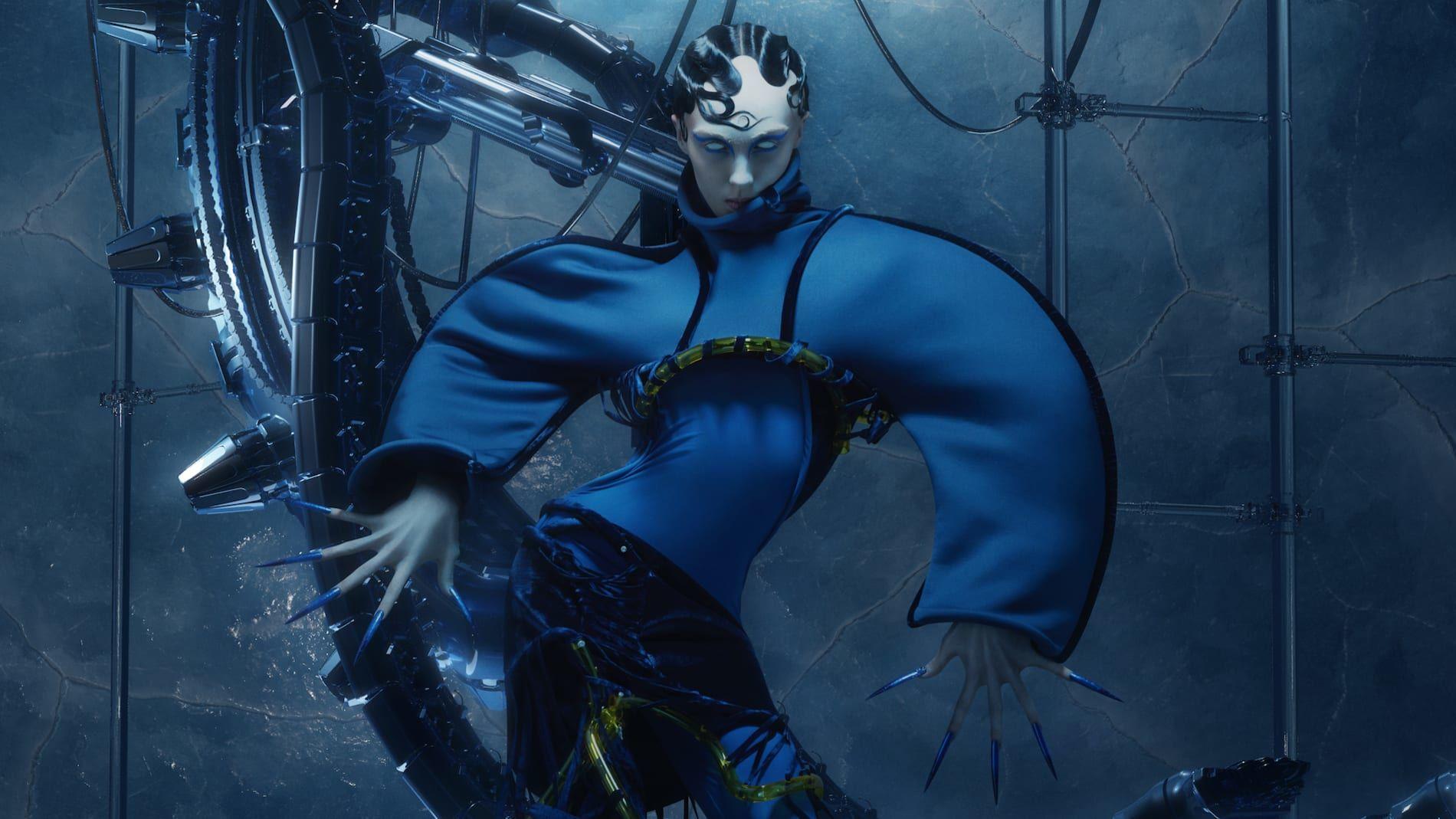 Figure wearing blue garment in robotic lanscape