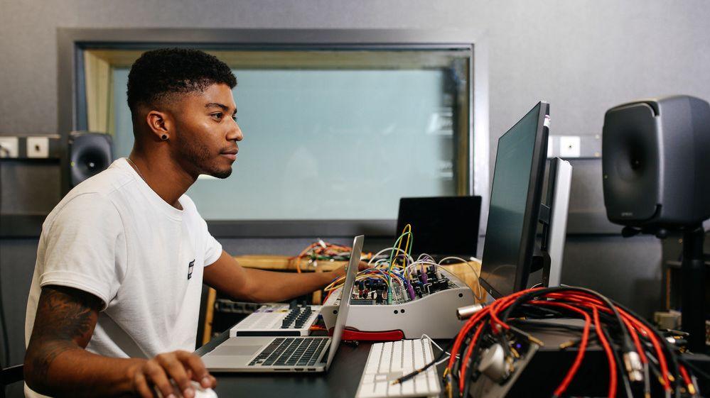 Man sitting at a desk.