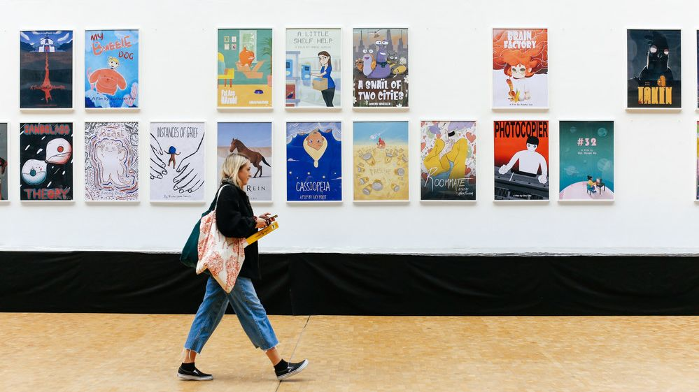 Girl walking past animation posters