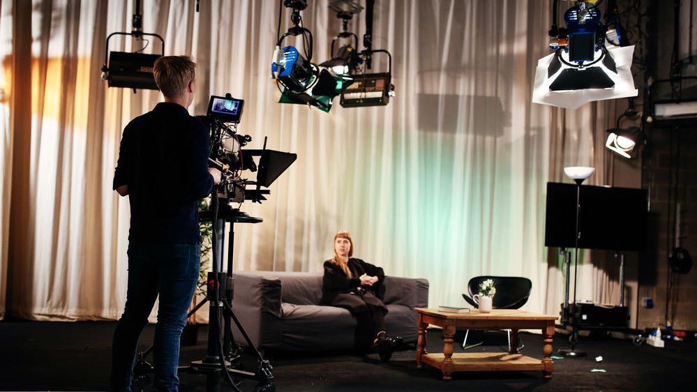 Students on set filming in the television studios