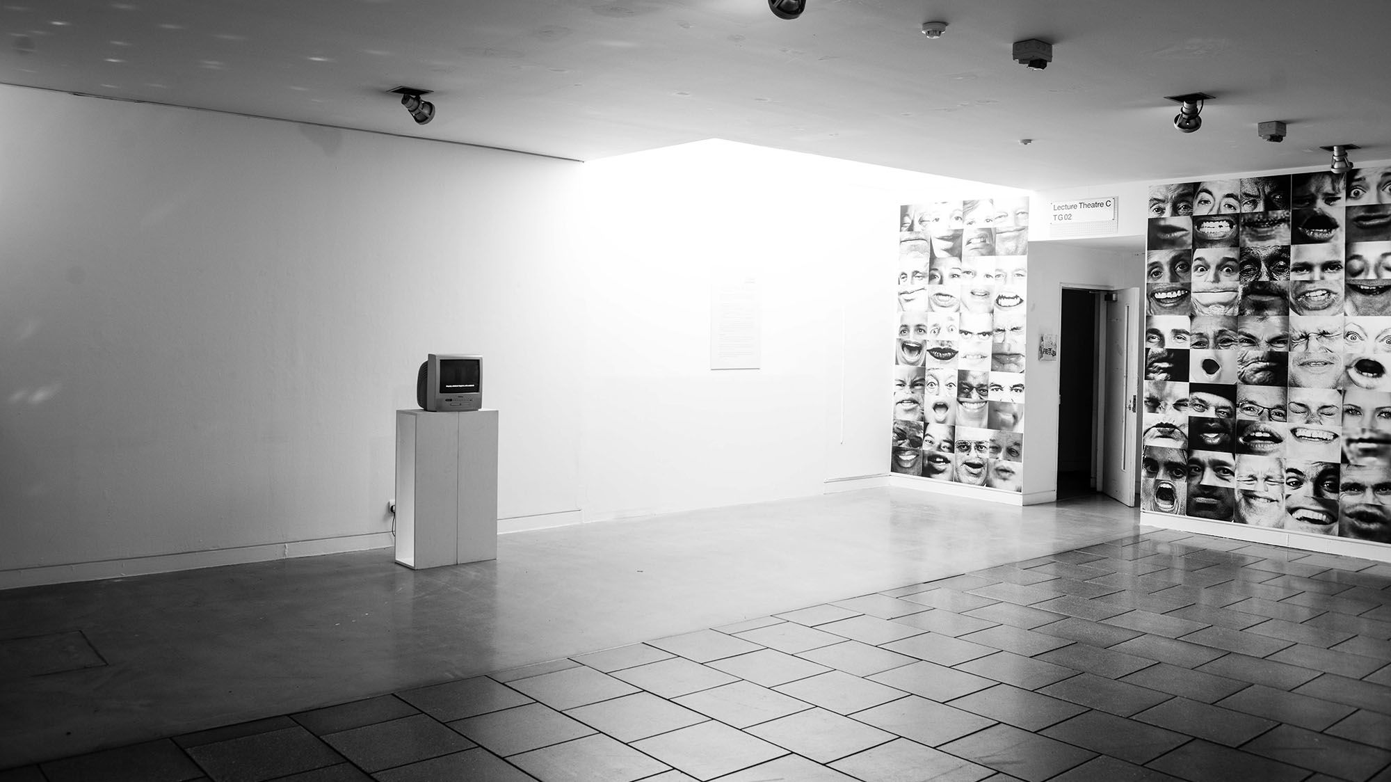 a black and white photo of an exhibition space