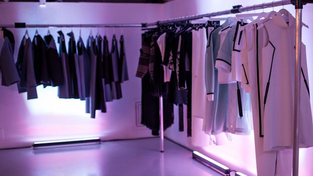 Student fashion collections on display at an exhibition.
