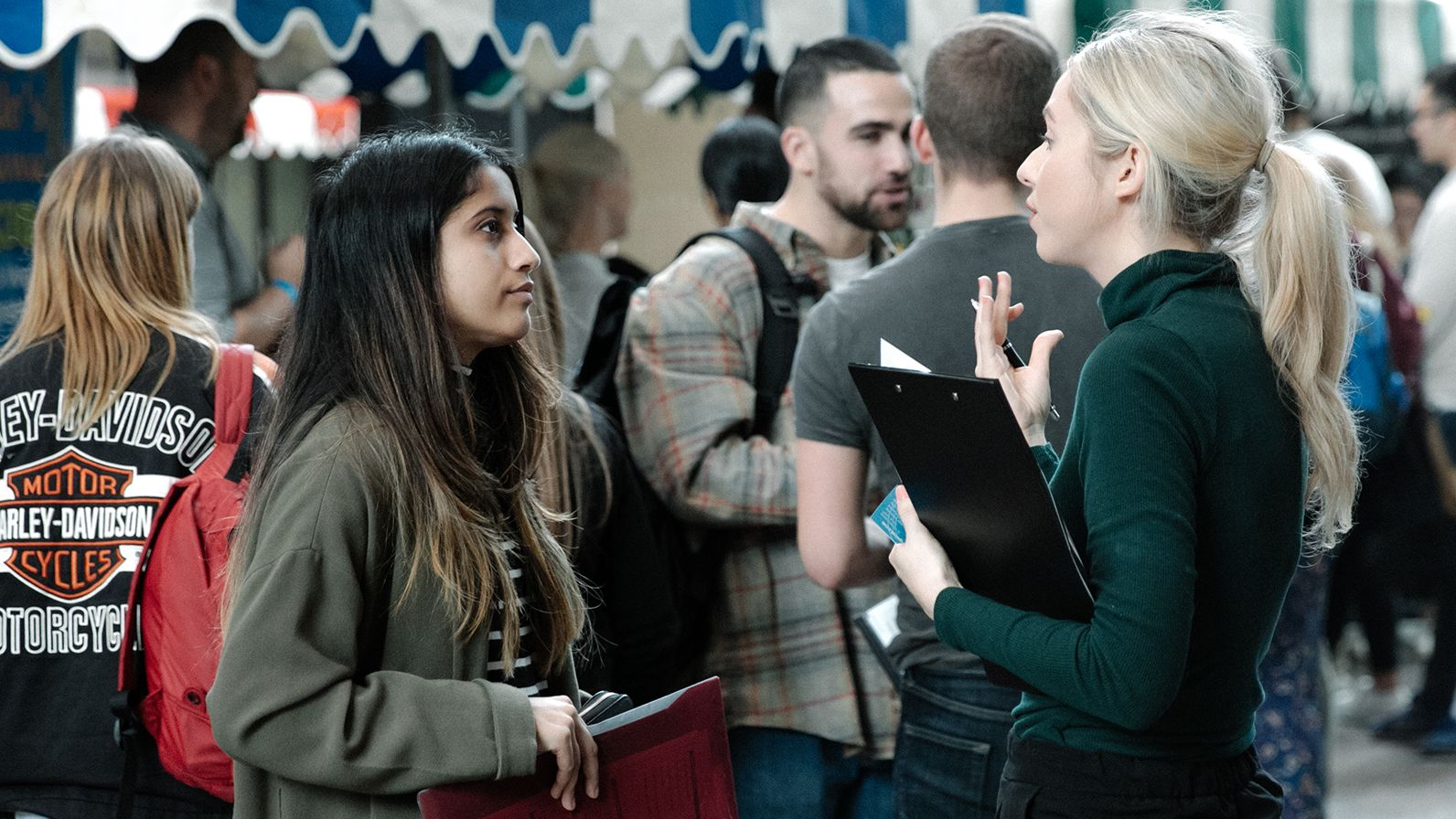 Woman speaking to a UAL student at the Part Time Jobs Fair