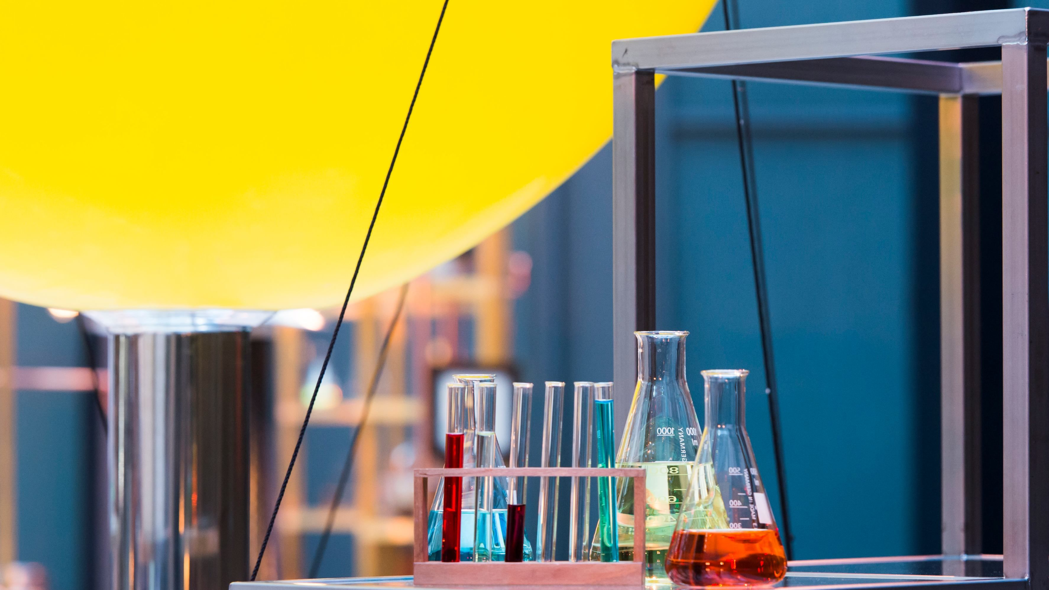 Science beakers with different colour liquids
