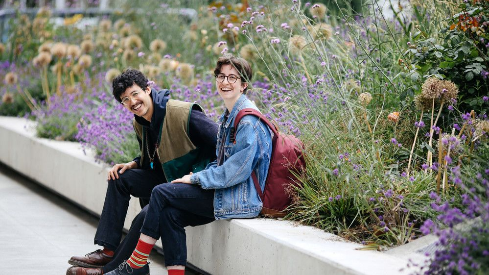 Students sit in the garden at Camberwell surrounded by flowers