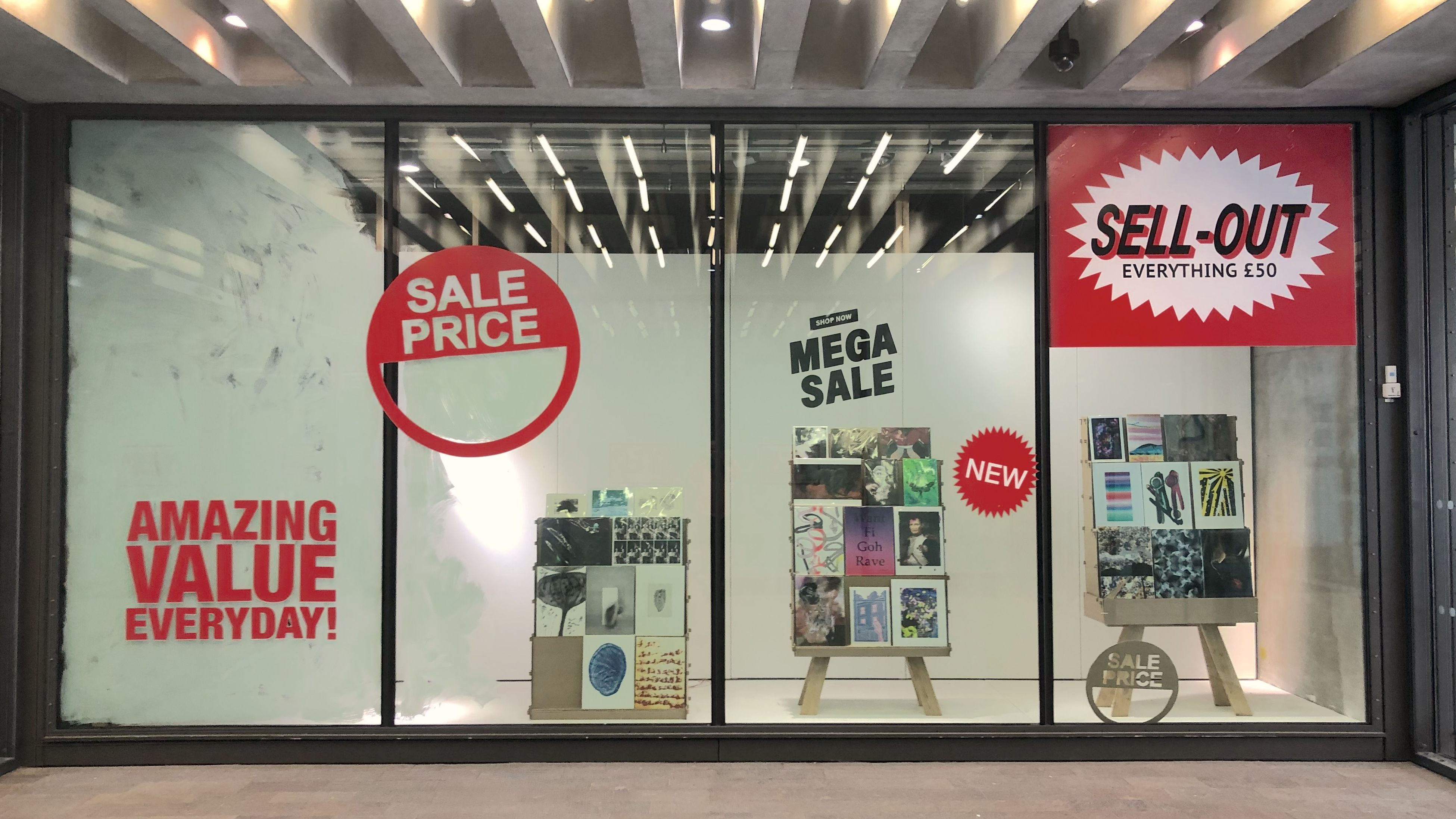 window gallery showing sell out signs in style of a shop
