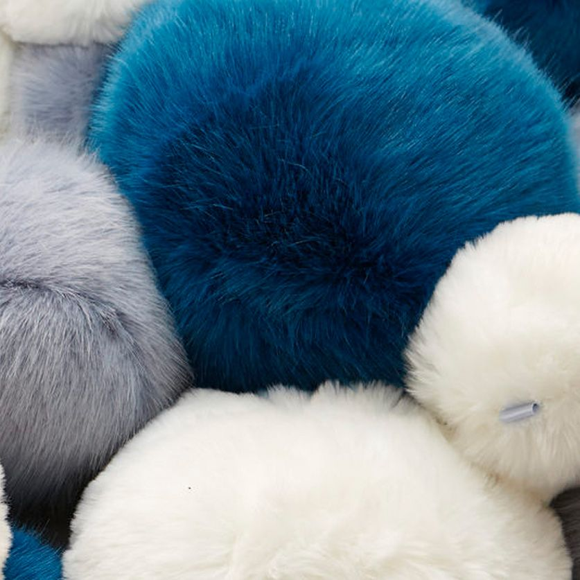 Close-up shot of blue, white and grey fluffy balls