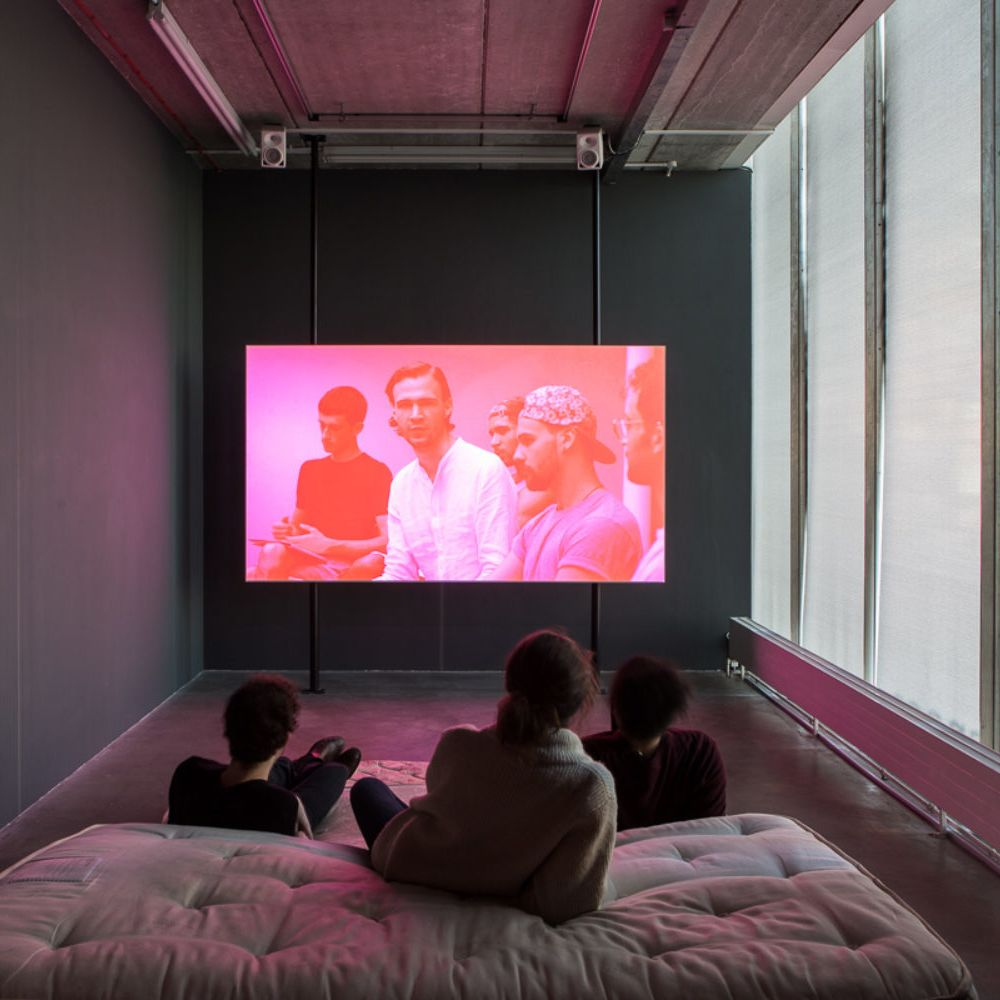 Students watching the Ian Giles After BUTT film in Chelsea Space gallery.