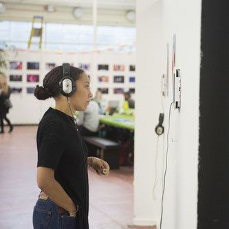 student listening to audio at an exhibition