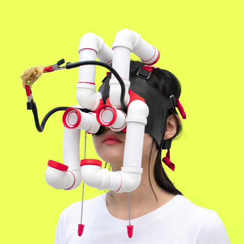 A person wearing a device over their face made up of connected tubes