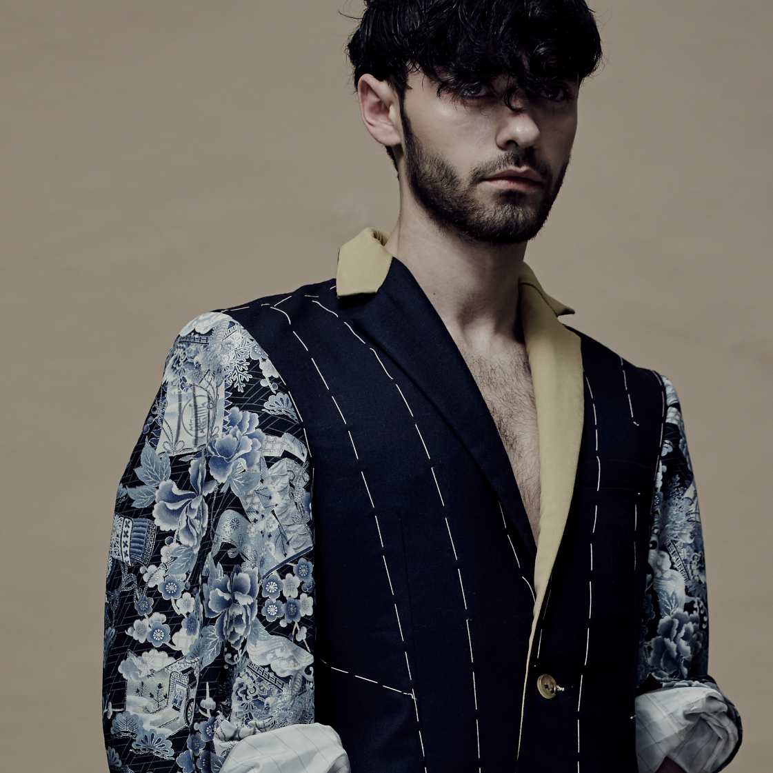 Male model in clothes visualising the tailoring process