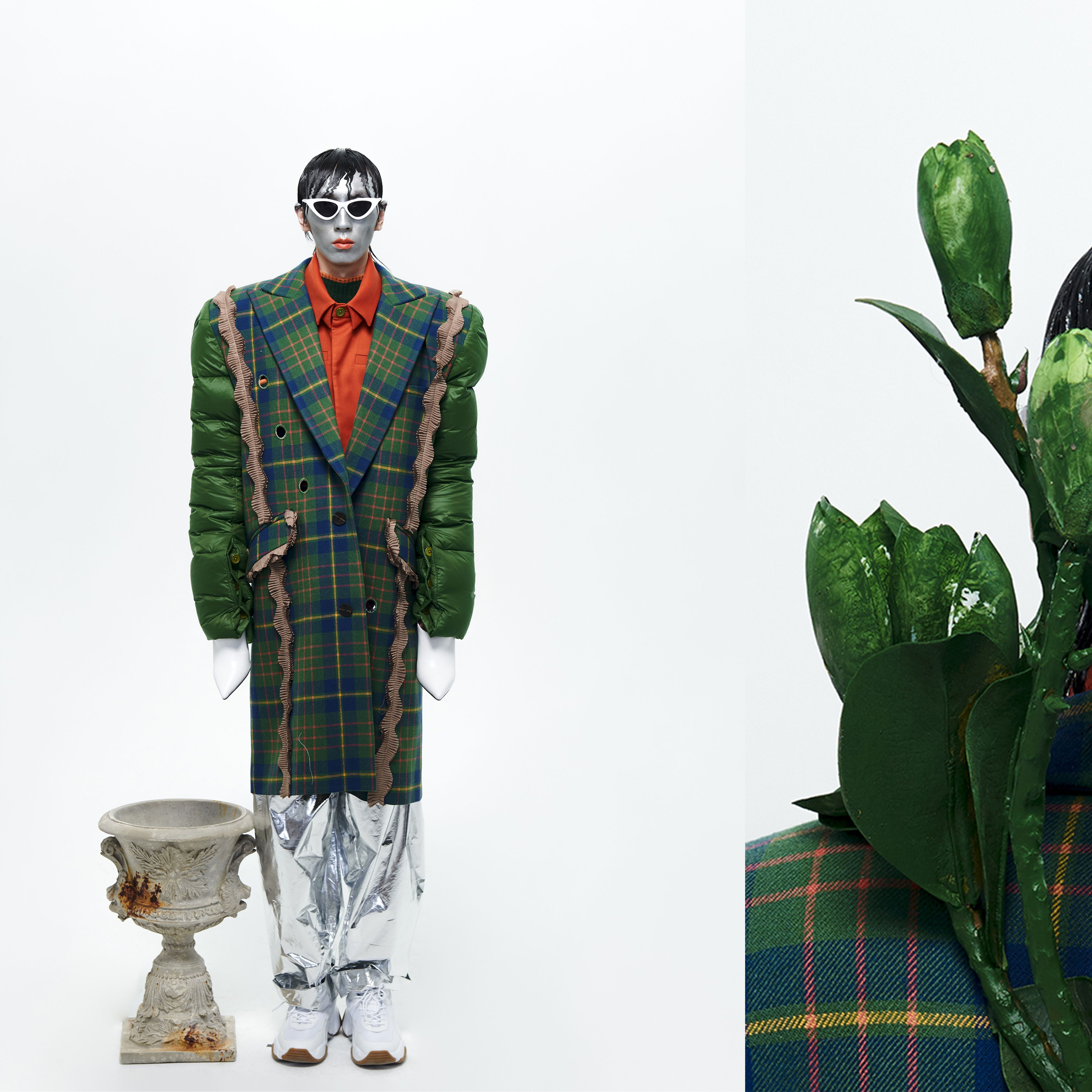 Male model in green tweed with emphasis on nature and plants.