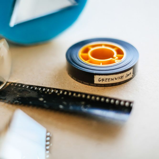 Film reel with magnifying glass
