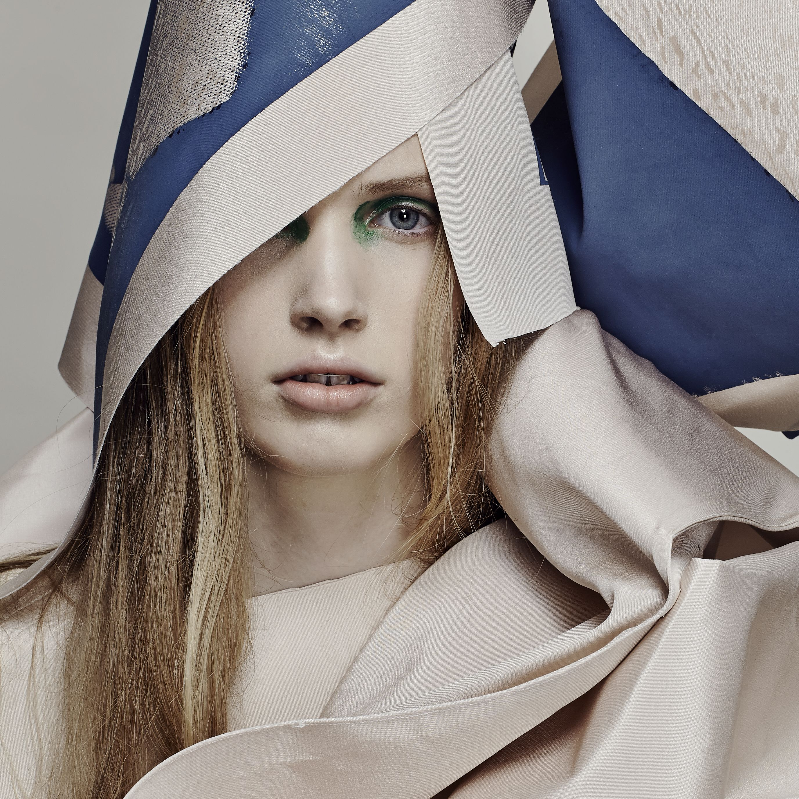 Female model in cream and blue material.