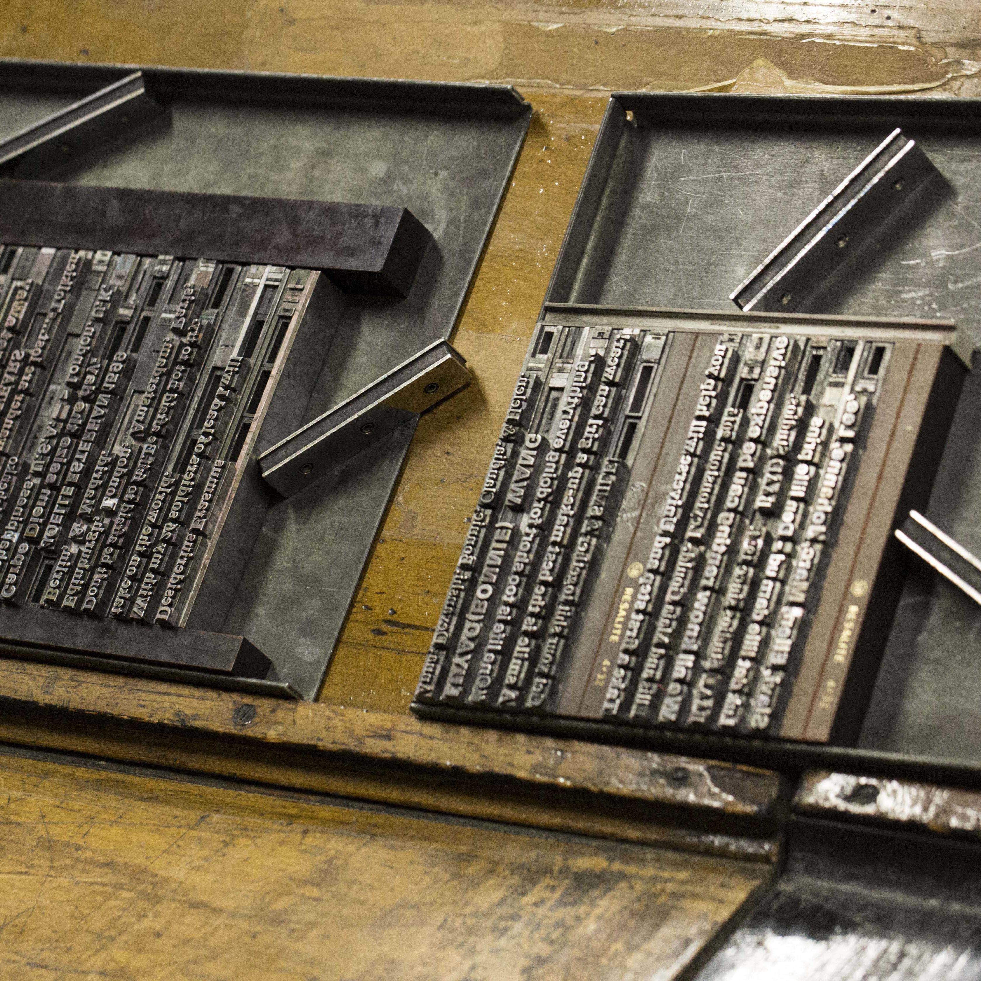 People using the letterpress at Central Saint Martins