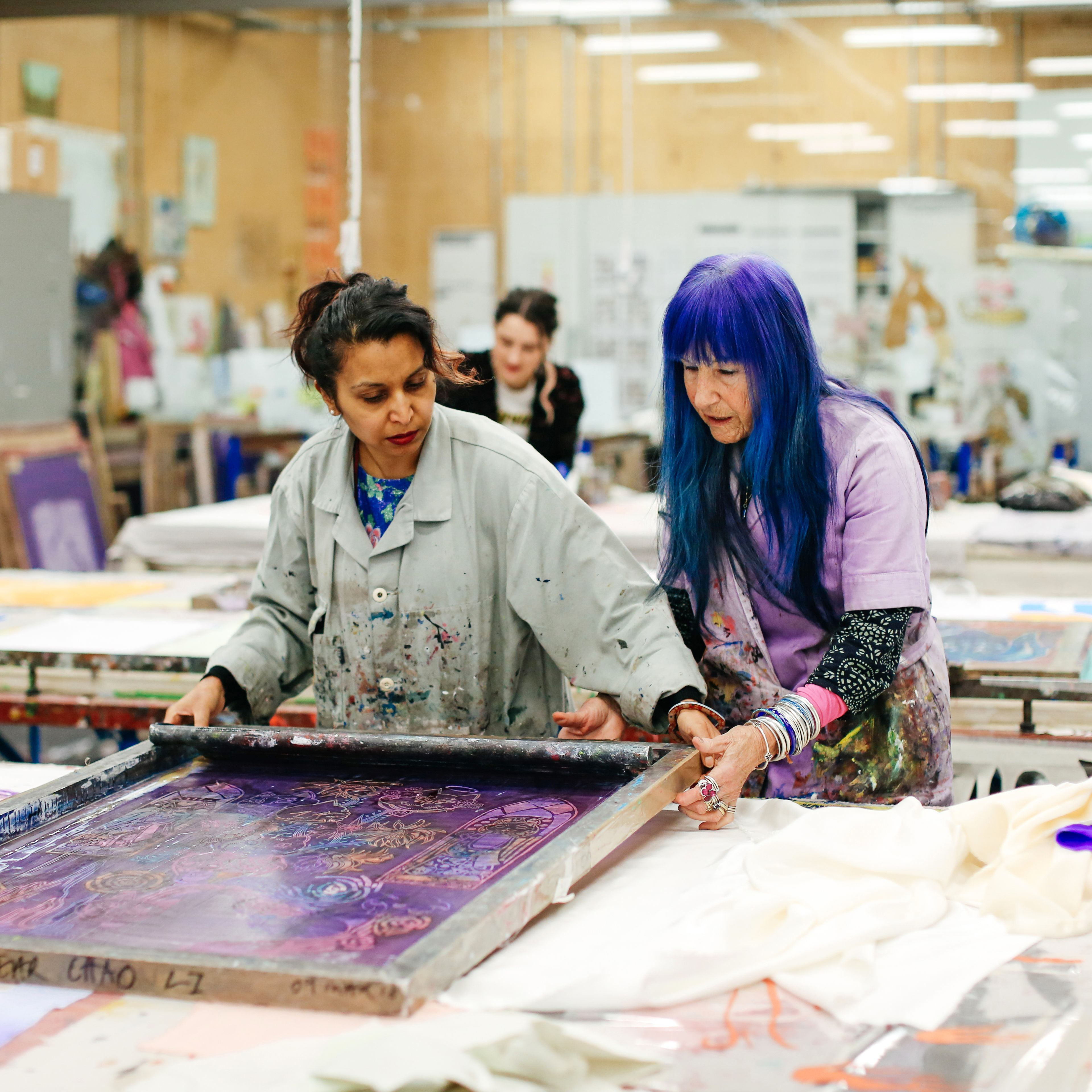 Two technicians in the print and dye workshop