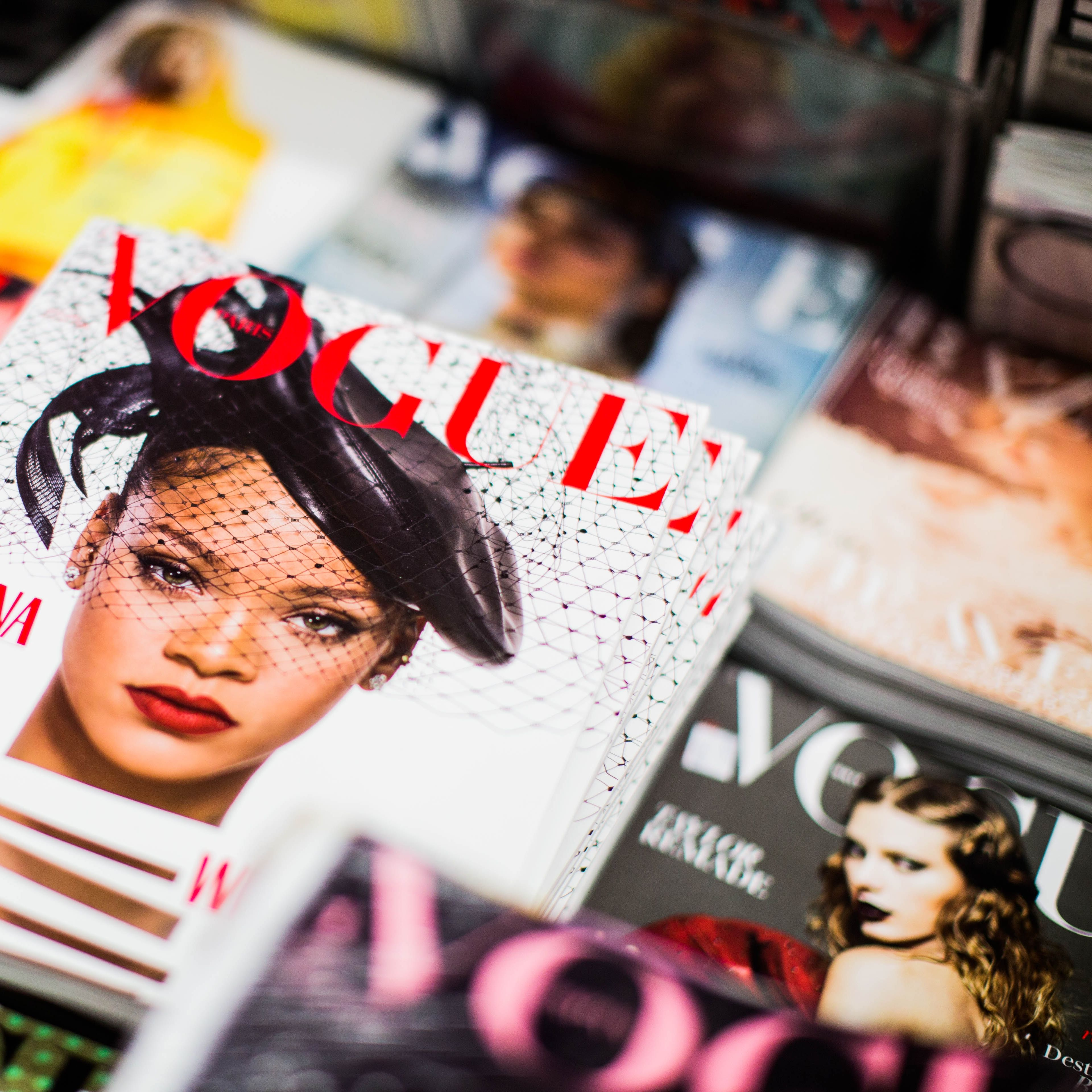 Close up of Vogue covers. The prominent cover features Rihanna.