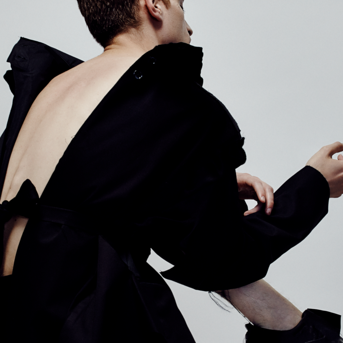 Male model in black outfit and shoes