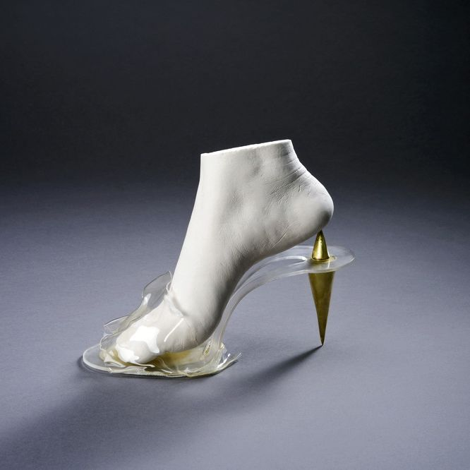 Glass shoe with golden heel