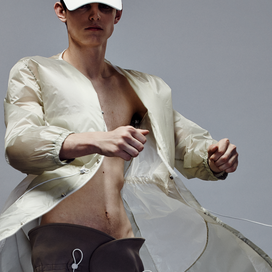 Male model in sports cap and jacket