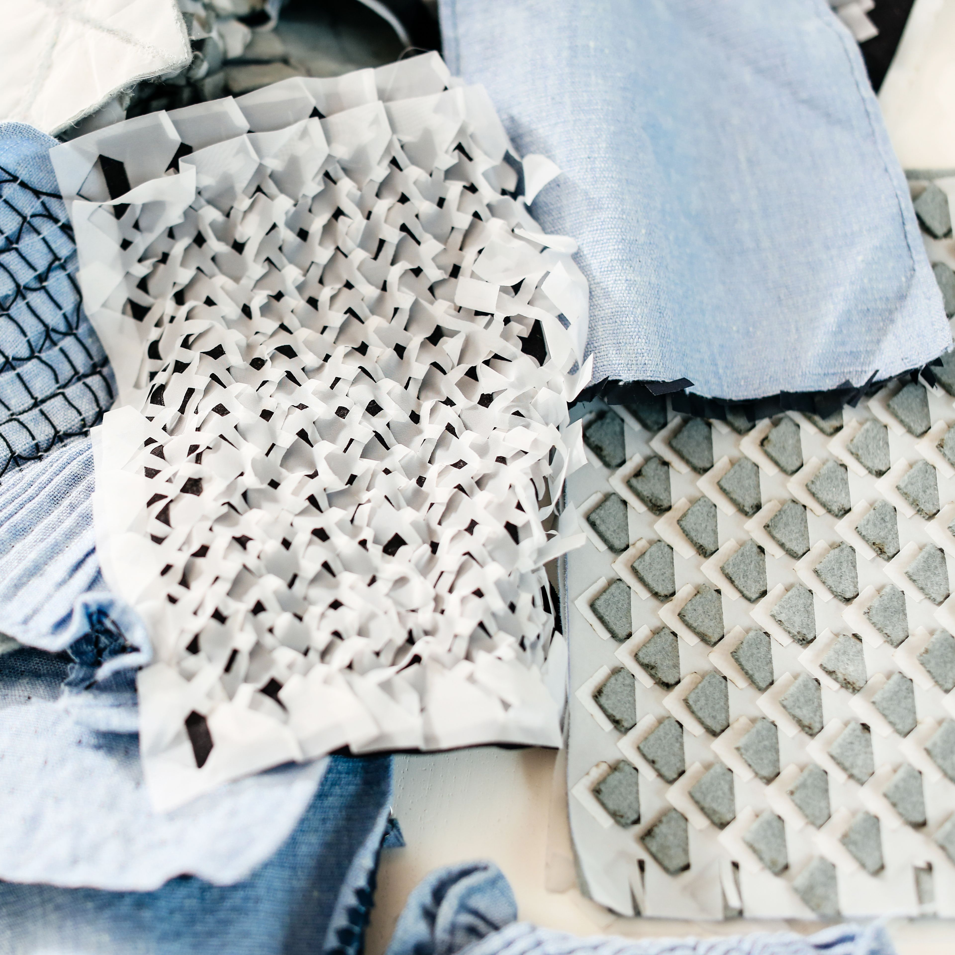 A collection of textured swatches in whites and blues.