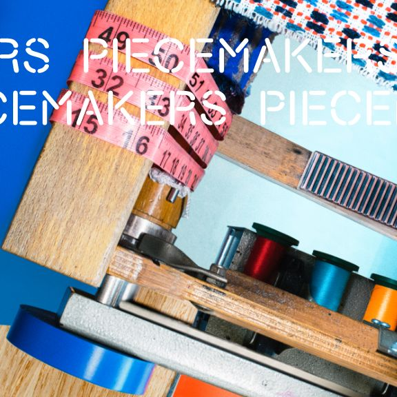 flat lay style image of thread spools on shelves, the shelving is held together by red measuring tape, and in front is a machine weaving a cloth. title PIECEMAKERS repeats across the top of the image.