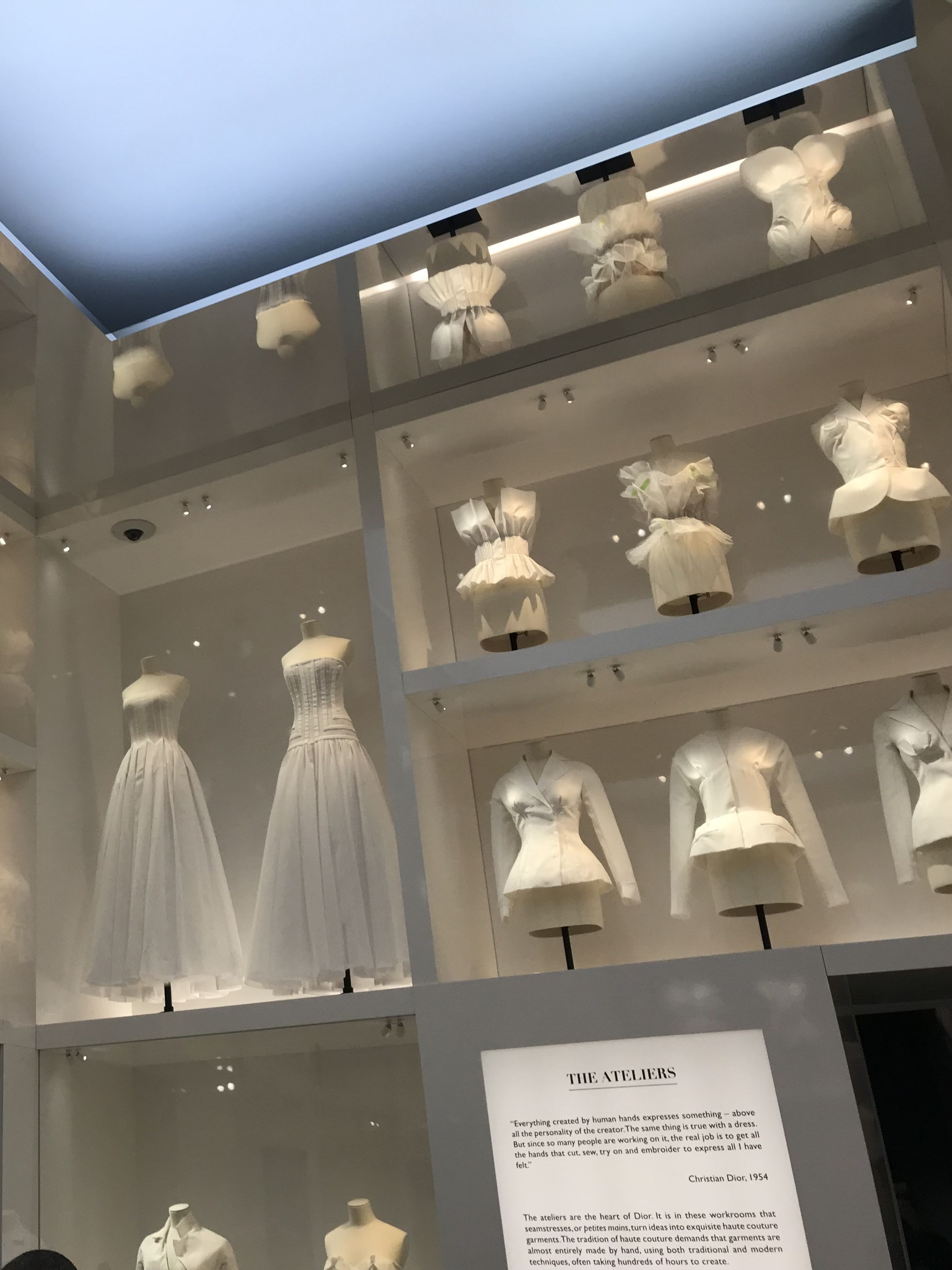 View of toile dresses in cabinets