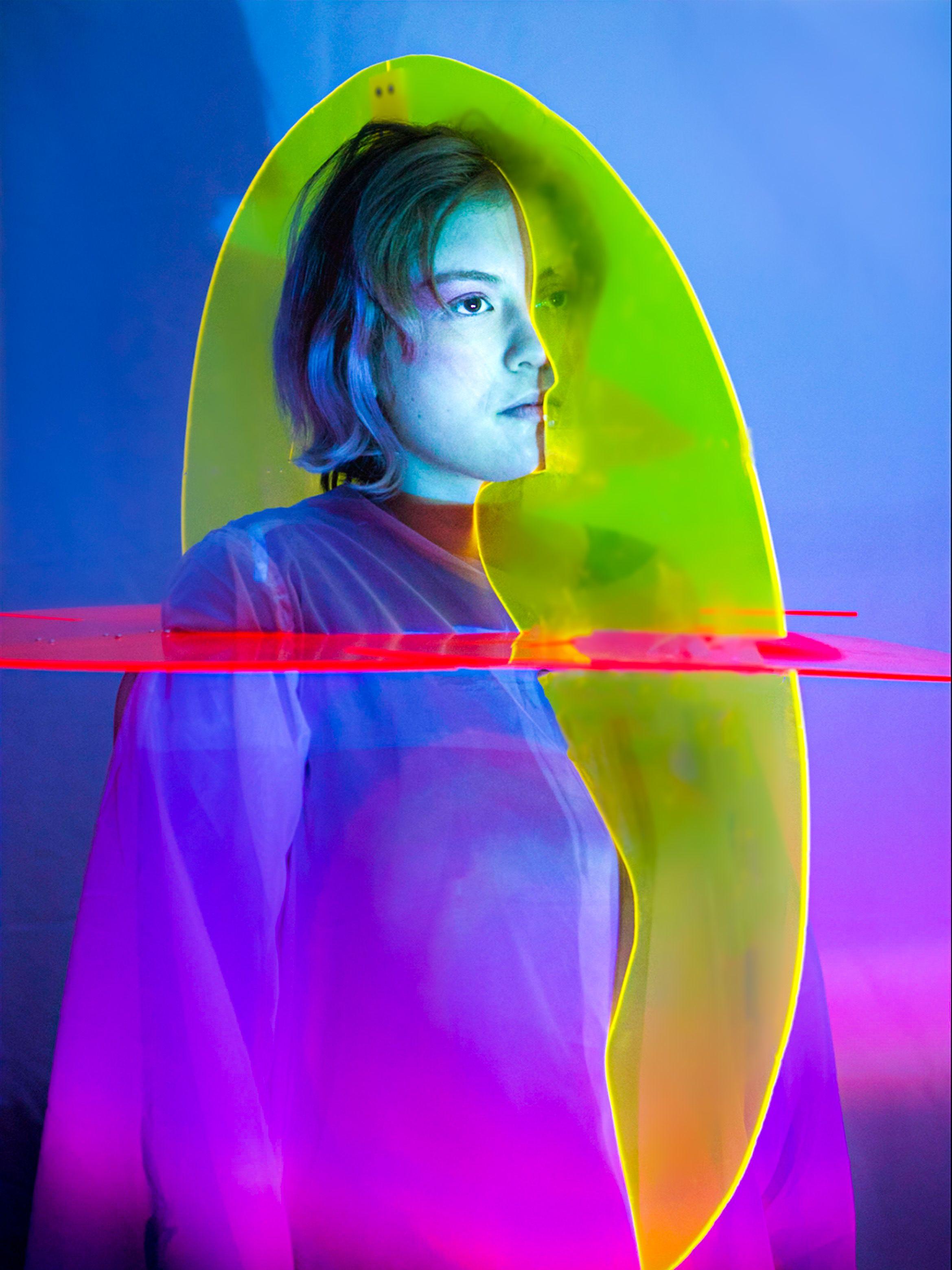 A model wearing a multi-coloured sculpture