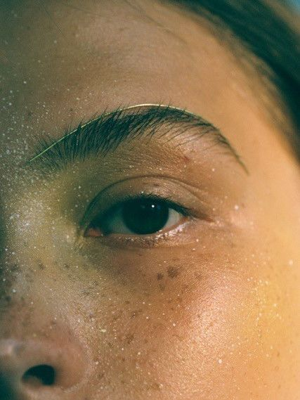 Close up of the left side of a woman's face showing an accessory on her eyebrow. MA Fashion, Film and Digital Production, work by Valerie Hsieh